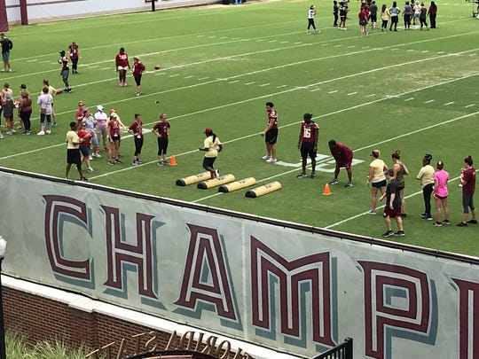 More than 300 women attended Saturday's football camp