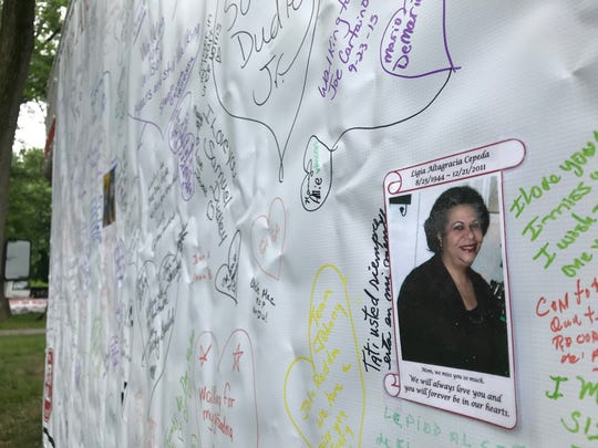 Friends and relatives of ALS victims wrote remembrances of their loved ones on a large board at the 2018 ALS Walk in Saddle Brook.