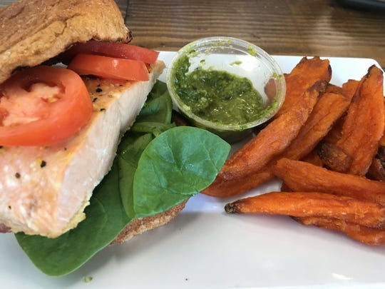 A salmon pesto sandwich with sweet potato fries at Get Fit Grill in West Des Moines.