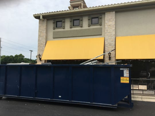 A trash receptacle was pulled up next to Parlor 88's patio area on June 4, 2018. The lounge closed May 30; new owners Stephen and Karen Williamson plan to open a new lounge, Whiskey Tango, around Aug. 1.