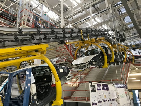 Inside the Avvocato Giovanni Agnelli Plant in Grugliasco, Italy, sections of what will eventually become Maseratis are carried along by an overhead conveyor system on May 31.