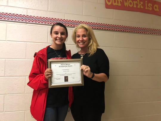Denise Mason (right) presents Jordan Cinelli (left) with a scholarship from the Alexis Mason Foundation.