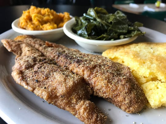 Catfish with sides of sweet potatoes, greens and cornbread