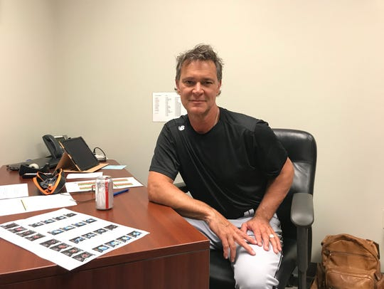 Don Mattingly in visiting manager's office at Busch