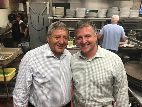 Mario and Anthony Daniele in the kitchen of their new