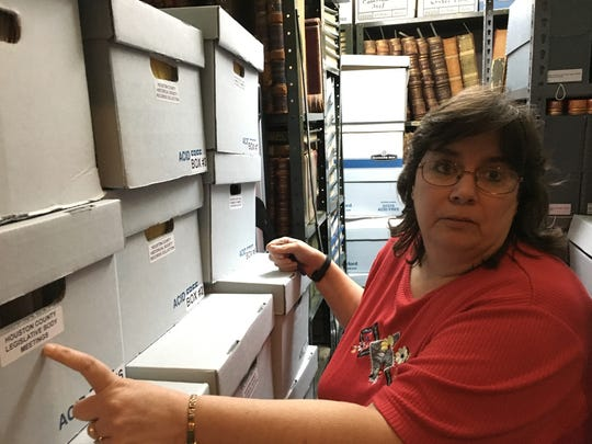 Houston County Archivist and Records Manager Melissa Barker describes how she locates records stored in boxes stacked from floor to ceiling inside a vault in the basement of Houston County Courthouse.