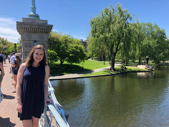 Natalie Campbell poses at the Boston Public Garden during her internship at Massachusetts General Hospital's Down Syndrome Program.