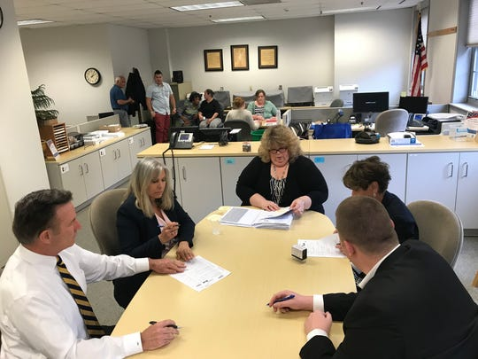 Dale Kramer, administrator of the Morris County Board of Elections, center, reviews rejected provisional ballots with election supervisors at the Morris County Board of Elections on Thursday, June 7, 2018.