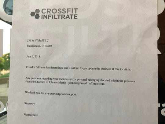 The sign posted on the front door of CrossFit Infiltrate