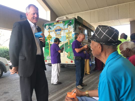 William Clayton (left), vice president of customer care at Reliant Energy, talks to 79-year-old Robert Jackson about why he loves the Beat the Heat Centers in Corpus Christi on Thursday, June 7, 2018.