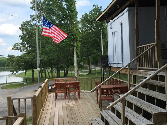 The store at Cane Creek Boat Dock has been renovated and tables have been added to an adjoining deck.