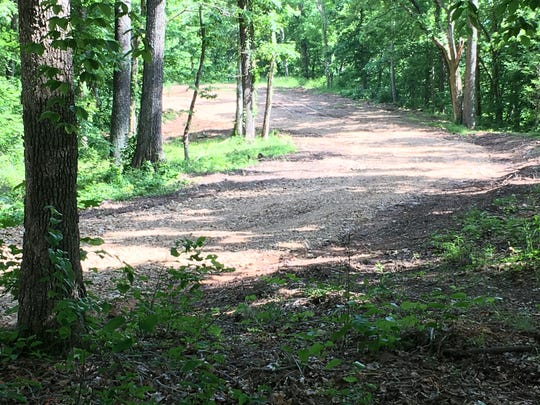Construction crews have been building an access road through Danville Park, along which they are constructing campsites for RVs.
