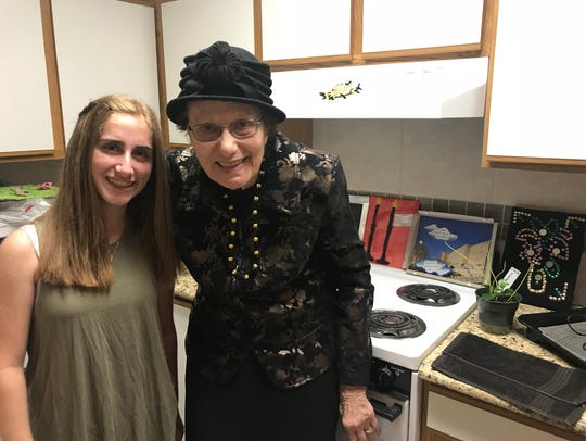 Ilana Feder, 14, and Rosalie Kallner, 86 pose in Kallner's