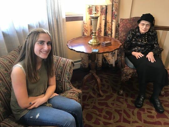 Ilana Feder, 14, and Rosalie Kallner, 86, talk at the