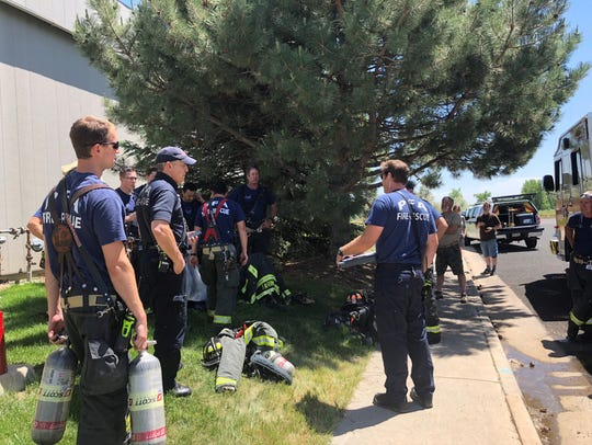 Poudre Fire crews debrief about the cause of a small