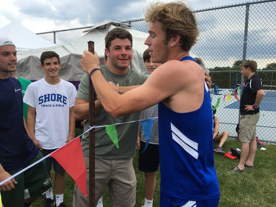An exhausted Drew Maher is greeted by friends and teammates