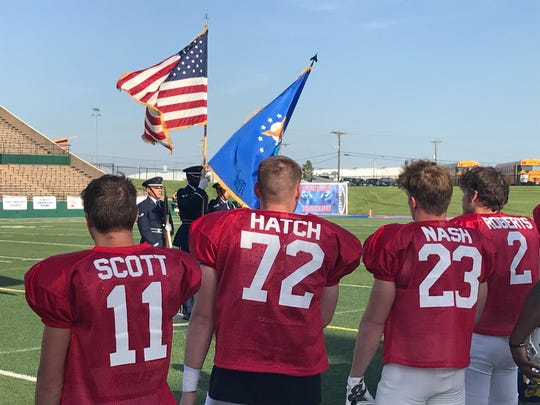 Players stand for the U.S. flag and playing of the