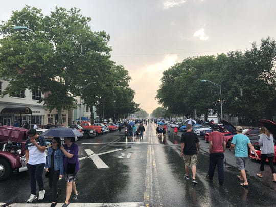 Classic cars stretched as far as the eye could see on Landis Ave. when looking westward from the Boulevard on Saturday evening as people braved the rain to enjoy the timeless vehicles