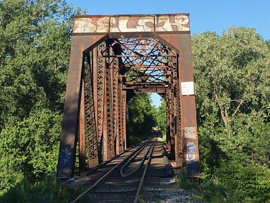 The Blue Bridge is a double-truss railroad bridge over