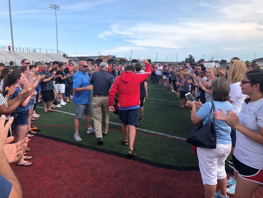 The Stratman family leaves the stadium at Lakota West
