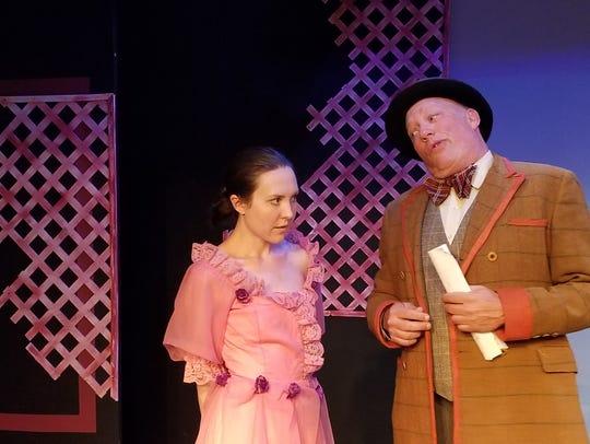 Salesman Charlie Cowell (Jim Bailey) warns Marian (Briana
