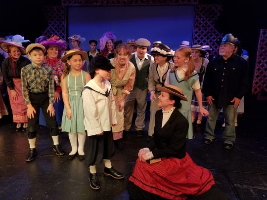 Winthrop Paroo (Chase Nelson, front left) regales Marian (Briana Lobbett) and the rest of the River City citizenry awaiting the arrival of the Wells Fargo Wagon.