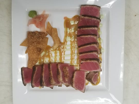 The ahi tuna comes as both an appetizer or a salad