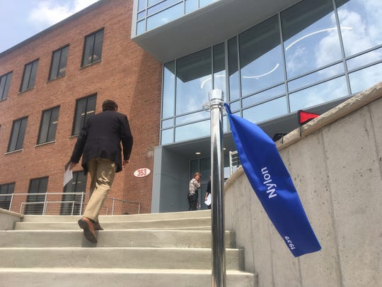 A man approaches the front entrance to a renovated DuPont building that officials say will help the company attract new talent.