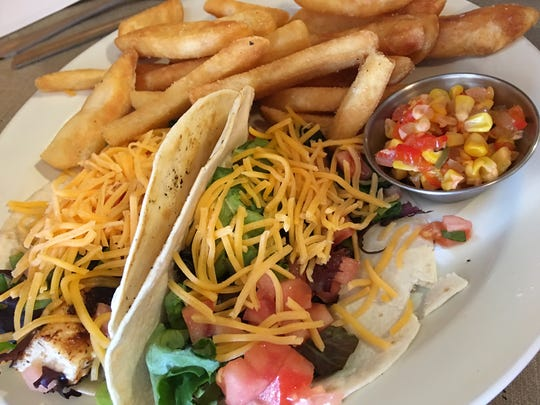 The mahi tacos at North by South Bistro in Satellite Beach feature chunks of fresh, blackened mahi and bell pepper chow chow on the side.