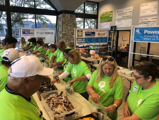 Nearly 50 Florida Power & Light Company employees prepare