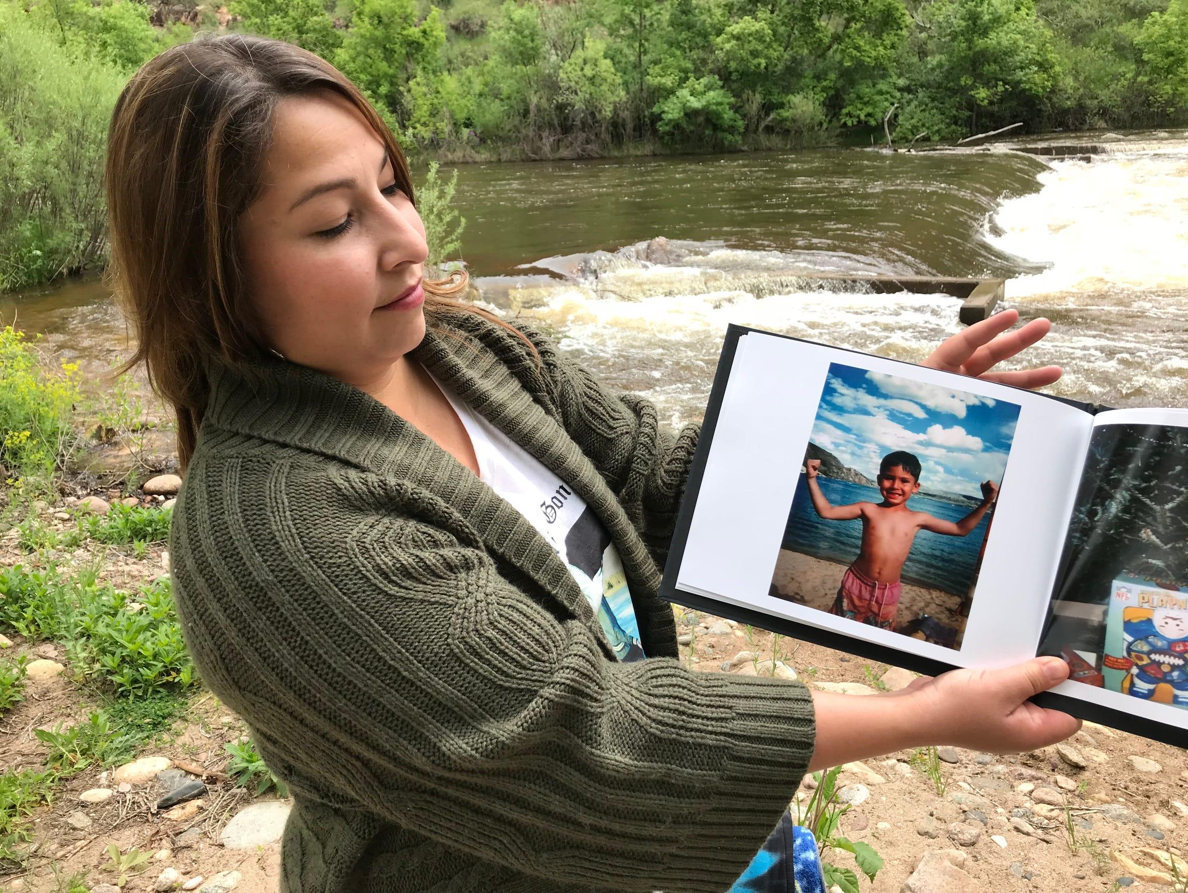 Amy Barcenas shows photos of her son Maximilian Lopez,