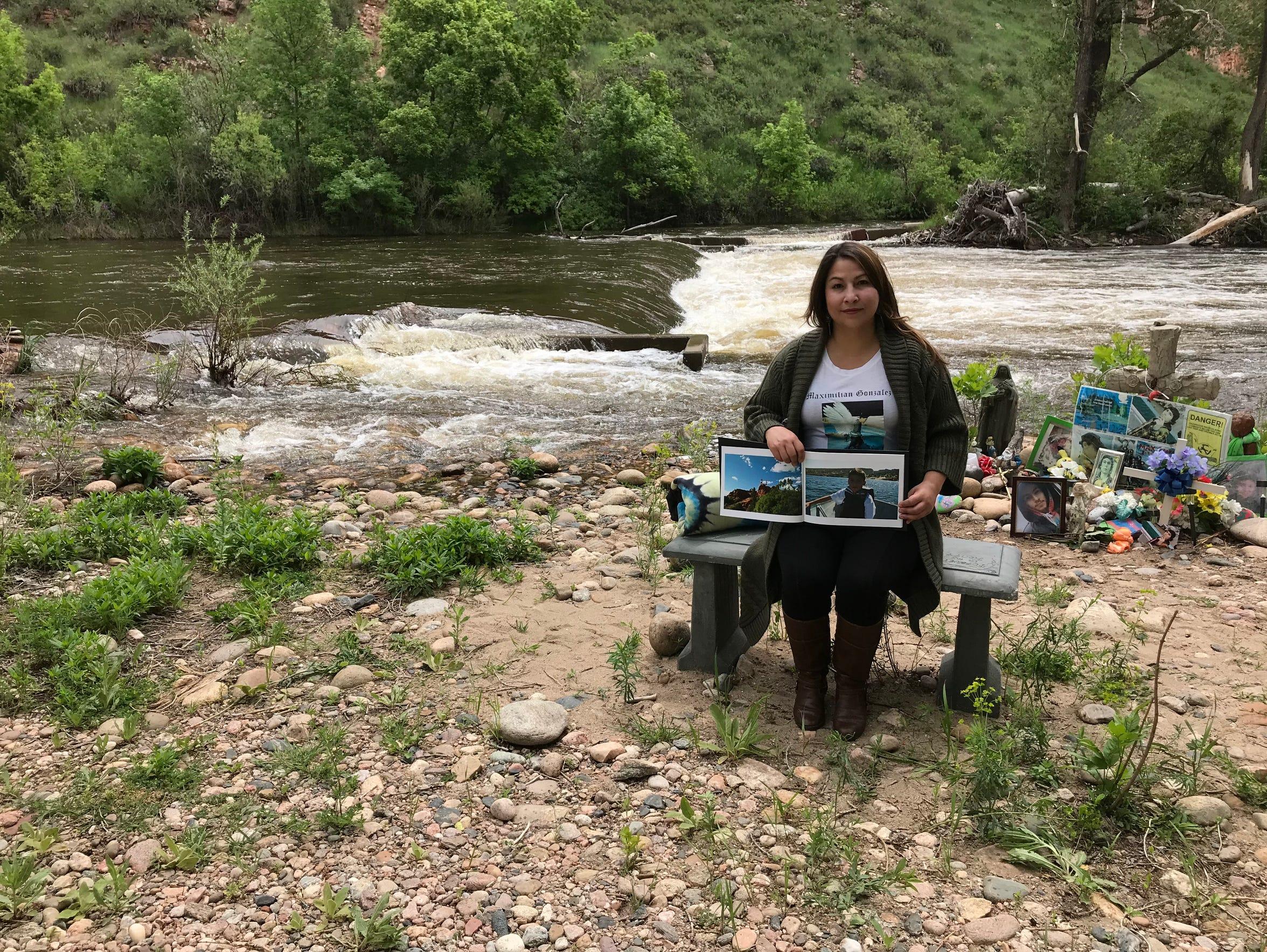 Amy Barcenas sits along the Poudre River near Watson