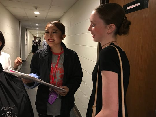 Dancer Rieko Hatato (left) reacts to gifts given to her by her Jackson ambassador family during the 2018 USA International Ballet Competition at Thalia Mara Hall in Jackson. Olivia Claire Williford, a member of the ambassador family, looks on.