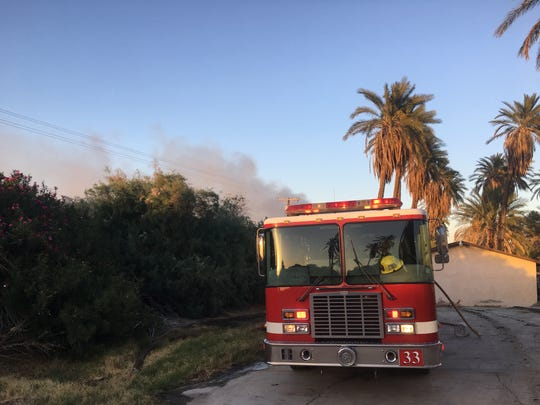 A Riverside County Fire Department fire truck is parked on a pathway onto the property where 62 firefighters are fighting an active vegetation fire.