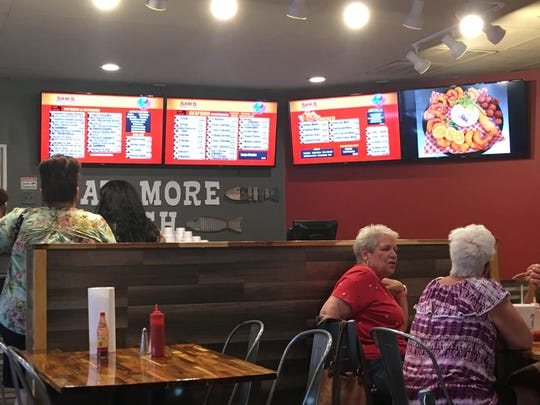The interior of Sam's Southern Eatery feels like a cross between a fast food joint and Southern diner. It has many fried options and southern classics like fried green tomatoes, and crawfish po'boy.