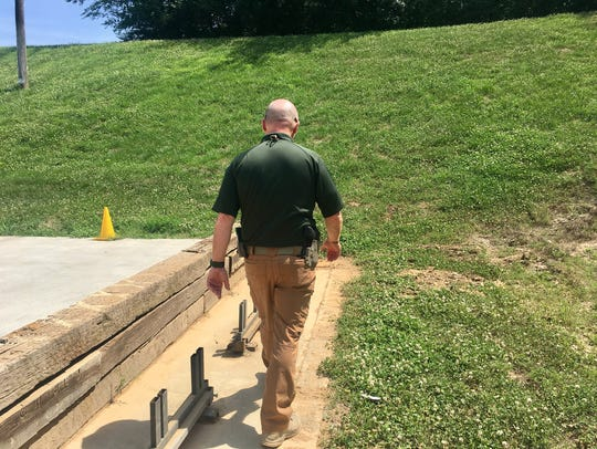 Williamson County Sheriff's Office Sgt. Denny Elliott walks behind the target bases at the WCSO gun range. Elliott has been the impetus for various improvements to the range over the past several years, but is still working to secure funding needed to remove several tons of lead from the berm.