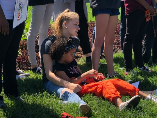 Havana Chapman-Edwards, 7, sits with another student on the lawn of the lawn of the U.S. Capitol to protest for gun-control on Tuesday, two years since the Pulse nightclub shooting in Orlando, Fla.