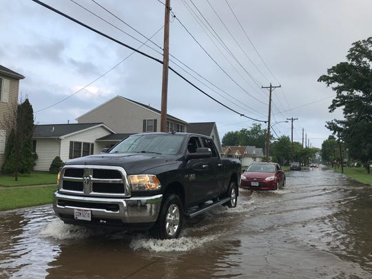 Heavy rainfall Tuesday, June 12, caused high water and flooding on dozens of Ottawa County roads, including East Second Street in Port Clinton.