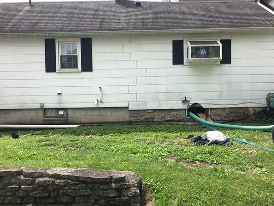 Todd Geyer's Locust Street home in Oak Harbor is draining,