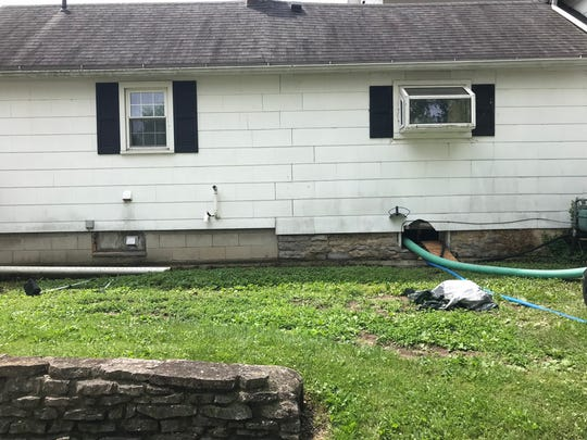 Todd Geyer's Locust Street home in Oak Harbor is draining, after four feet of water soaked his basement.