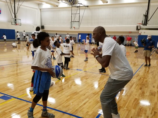 Memphis men's basketball coach Penny Hardaway instructs a camper at his basketball camp Wednesday.