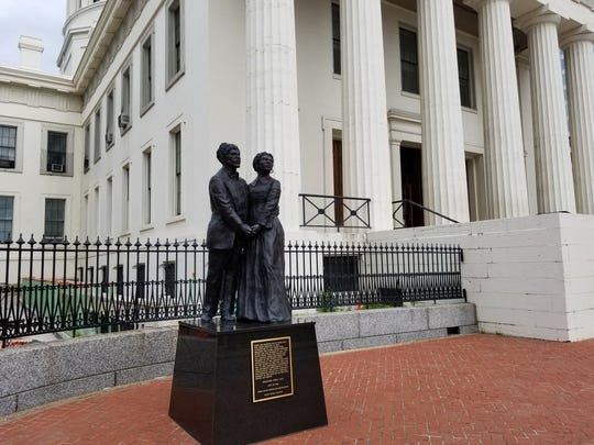 A bronze statue of Dred and Hariet Scott stands in