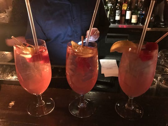 Head downstairs to the cellar tavern at The Olde Pink House in Savannah to enjoy a Pink Lady drink and listen to the piano.