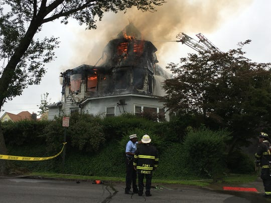 A fire destroys a home at the corner of Fourth Street
