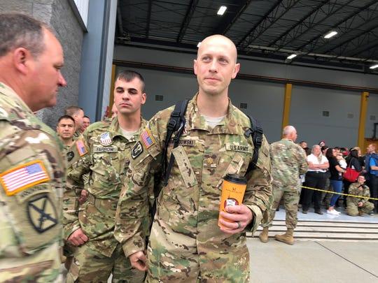 Maj. Jamie Lewandowski, the commander of Charlie Company, gets a last cup of Maplefield's coffee before deploying on June 14, 2018