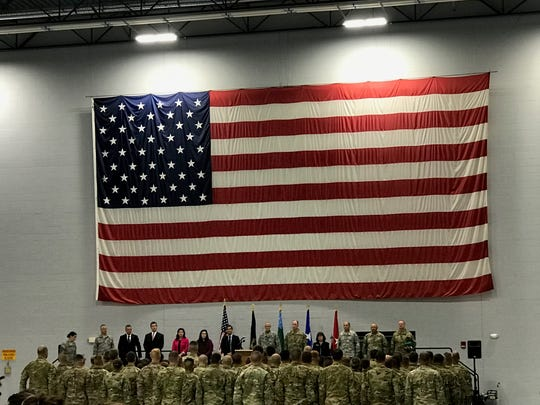 A deployment ceremony was held on June 14 for members of the Vermont Army National Guard. Standing before the company are Governor Phil Scott and Burlington Mayor Miro Weinberger, among others.
