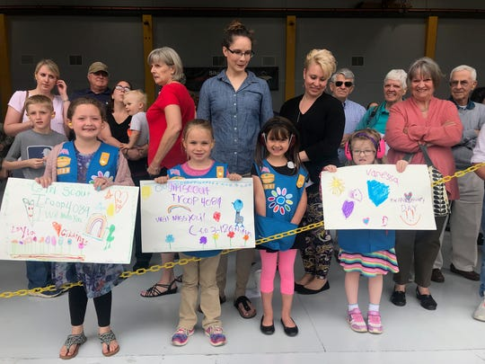 Members of Girl Scout Troop 4089 from Keeseville, New York made signs and waved goodbye as members of the Vermont Army National Guard were deployed on Thursday. From left: Layla Giddings, Abigayle Payro, Clara Wilson, and Vanessa Ballentine.