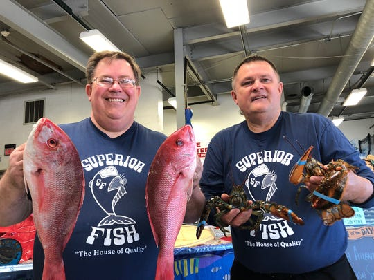 Kevin, left, and David Dean, co-owners of Superior Fish Co. in Royal Oak display sea creatures for sale June 14, 2018 ahead of their closing later this month.