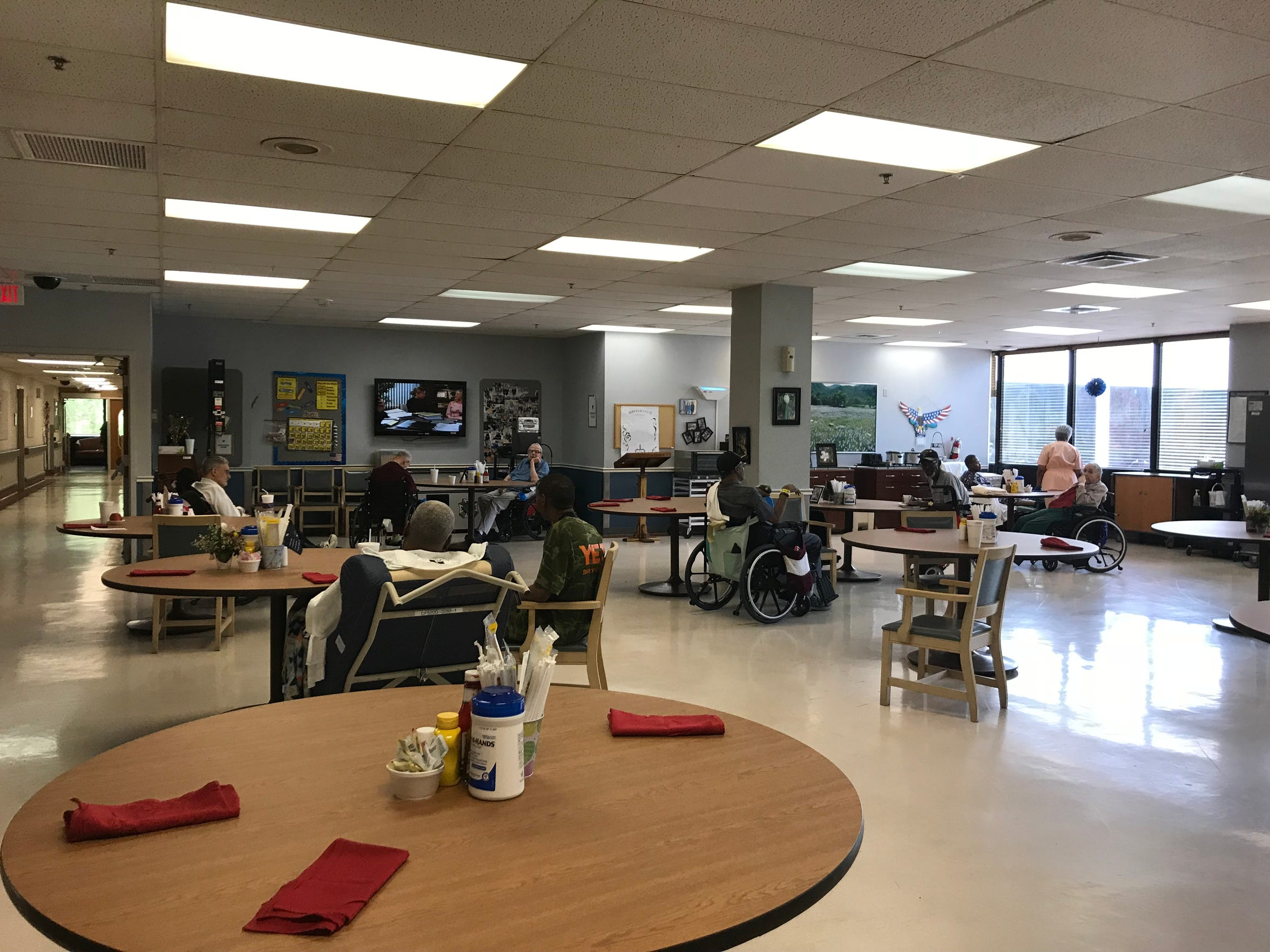 Residents at G.V. (Sonny) Montgomery VA Medical Center's community living center congregate in the cafeteria. The nursing home has a two-star quality rating, according to newly released data.