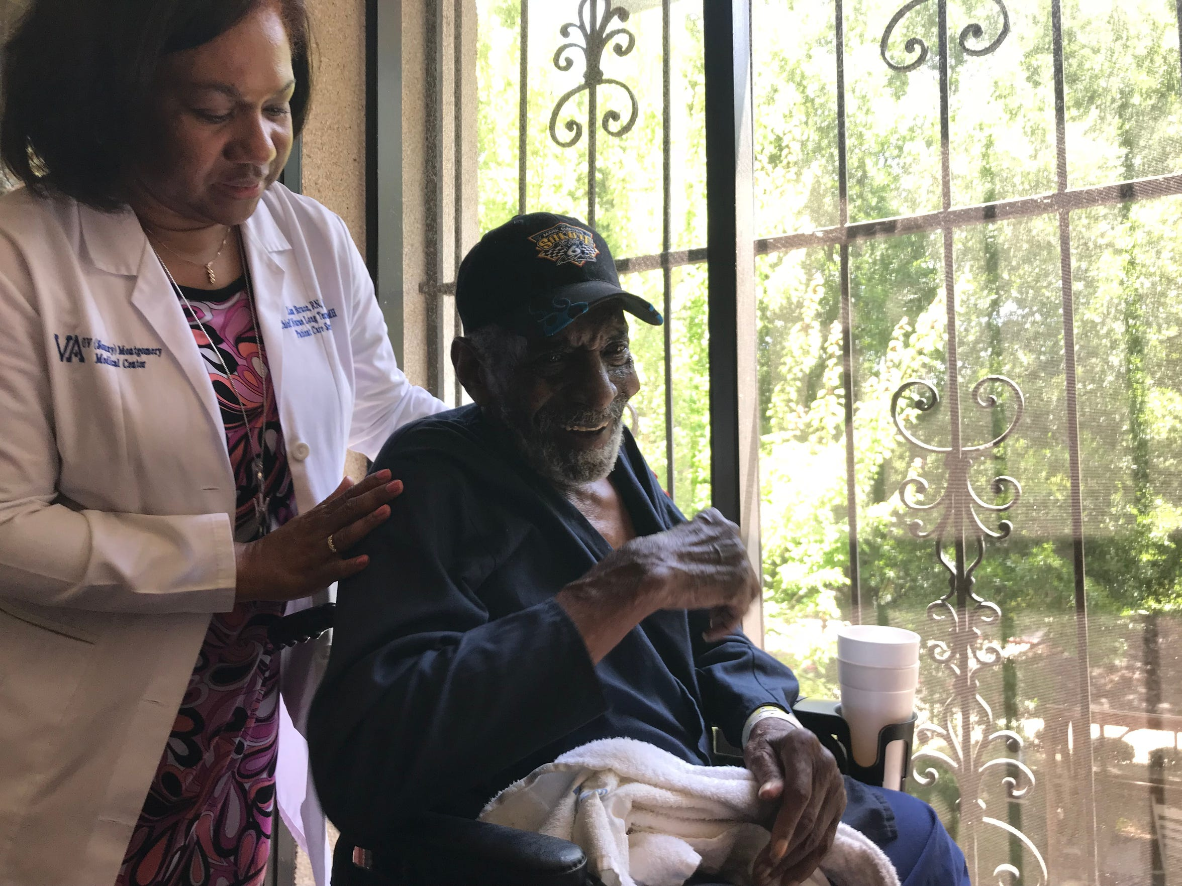 "Lisa Bruce, chief nurse for long-term care at the G.V. (Sonny) Montgomery VA Medical Center, greets one of the residents, Ananias Catchings. Of the VA nursing home, Catchings said, ""it's home. To me it is."""